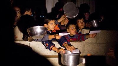 سكان  اليرموك  المحاصرون من الأسد يأكلون القطط والكلاب