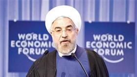حسن روحاني الرئيس الإيراني خلال إلقاء كلمته في منتدى دافوس الاقتصادي في سويسرا أمس (أ ب)