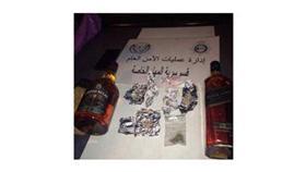 القبض على مصري بحوزته خمر مستورد وكوكتيل ممنوعات بـ«الخيران»