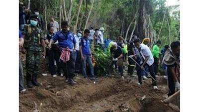 العثور على 139 جثة بالمقابر الجماعية في ماليزيا