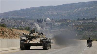 دبابة للثوار على طريق اللاذقية