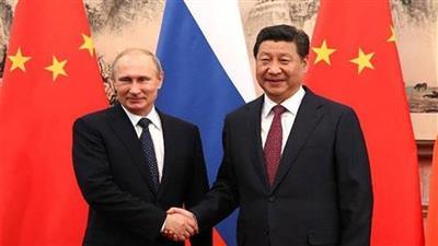 الرئيس الروسي فلاديمير بوتين ونظيره الصيني شي جين بينج