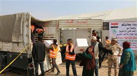 الهلال الاحمر يوزع 12 ألف و400 سلة غذائية وصحية على النازحين العراقيين
