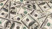 الدولار يهبط بفعل التكهنات بشأن توجهات المركزي الأوروبي