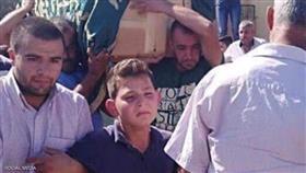 ابن محمد الدهيبي أثناء تشييع والده