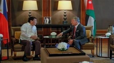 الملك الأردني والرئيس الفلبيني
