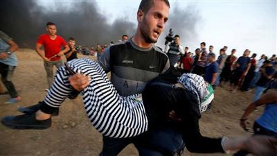 غزة.. شهيدان و100 جريح برصاص الاحتلال