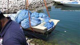 فريق الغوص يرفع خمسة أطنان من المخلفات في نقعة الفحيحيل