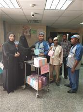 نسائية إعانة المرضى توزع وجبات إفطار على العمالة بالمستشفيات