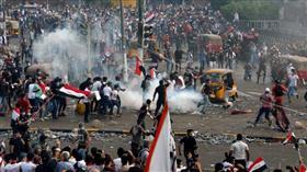 القوات الأمنية العراقية تبدأ فض اعتصام الجسور