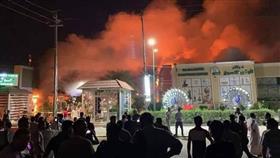 مصرع وإصابة 21 متظاهرا وحرق مجمع تجاري في مدينة النجف العراقية