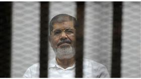 كواليس دفن د.محمد مرسي.. الداخلية المصرية سمحت لابنه المحبوس بتشييعه