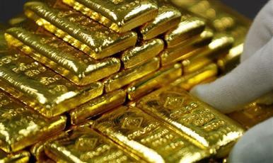 الذهب يبلغ ذروة أسبوع مع تراجع الدولار